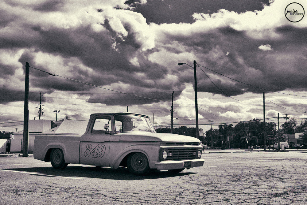 Classic cars in black and white photos. What are they?