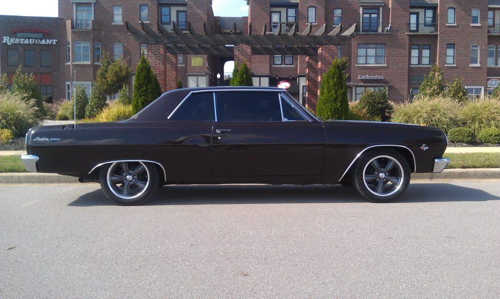 Almost a pro-touring setup on this black 1965 Chevelle Malibu
