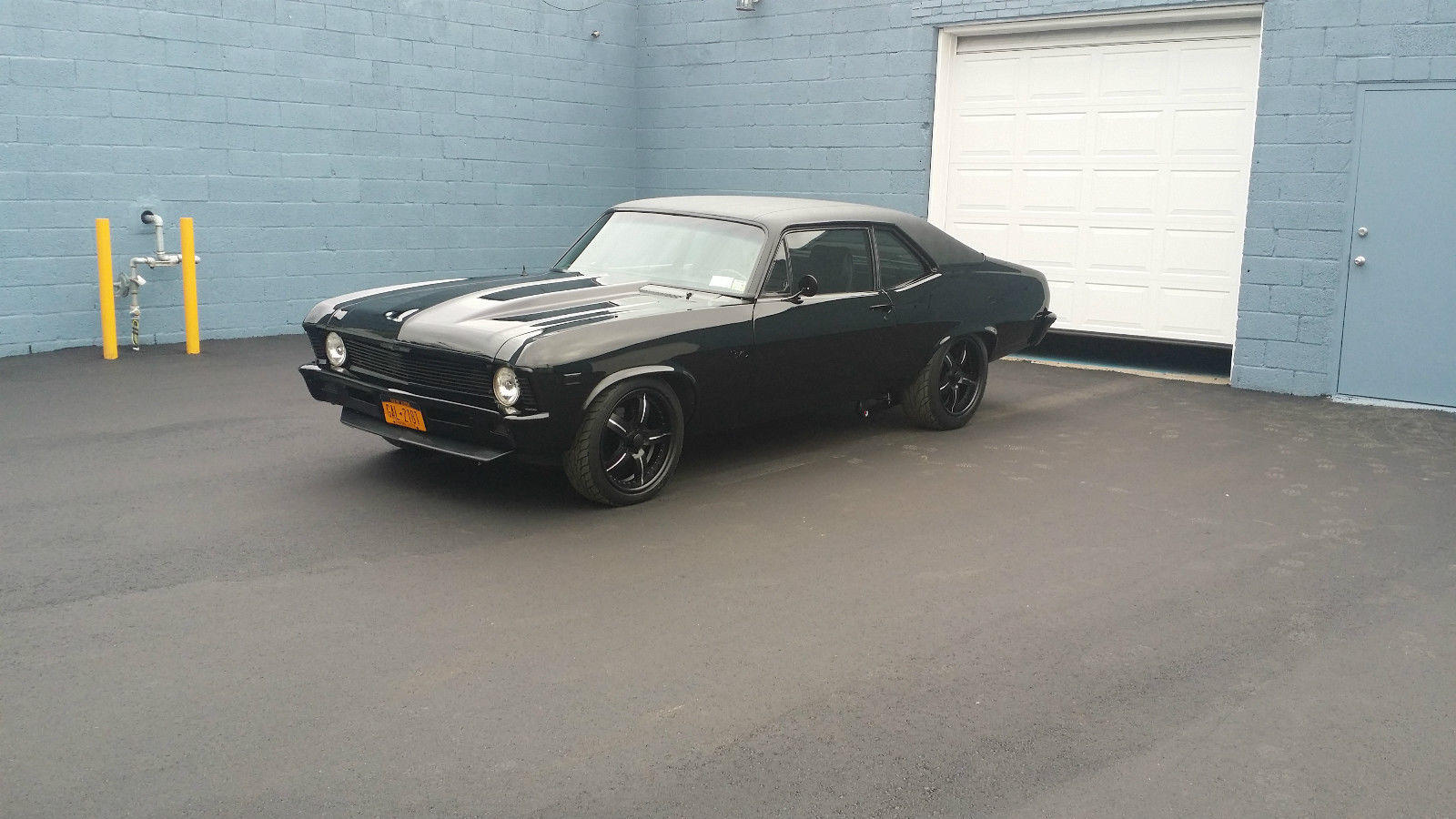 A 1969 Chevy Nova with Murdered out Pro Touring Treatment