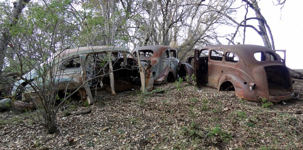 Abandoned Old Vintage Cars Sitting on Hillside on Central Coast of ...