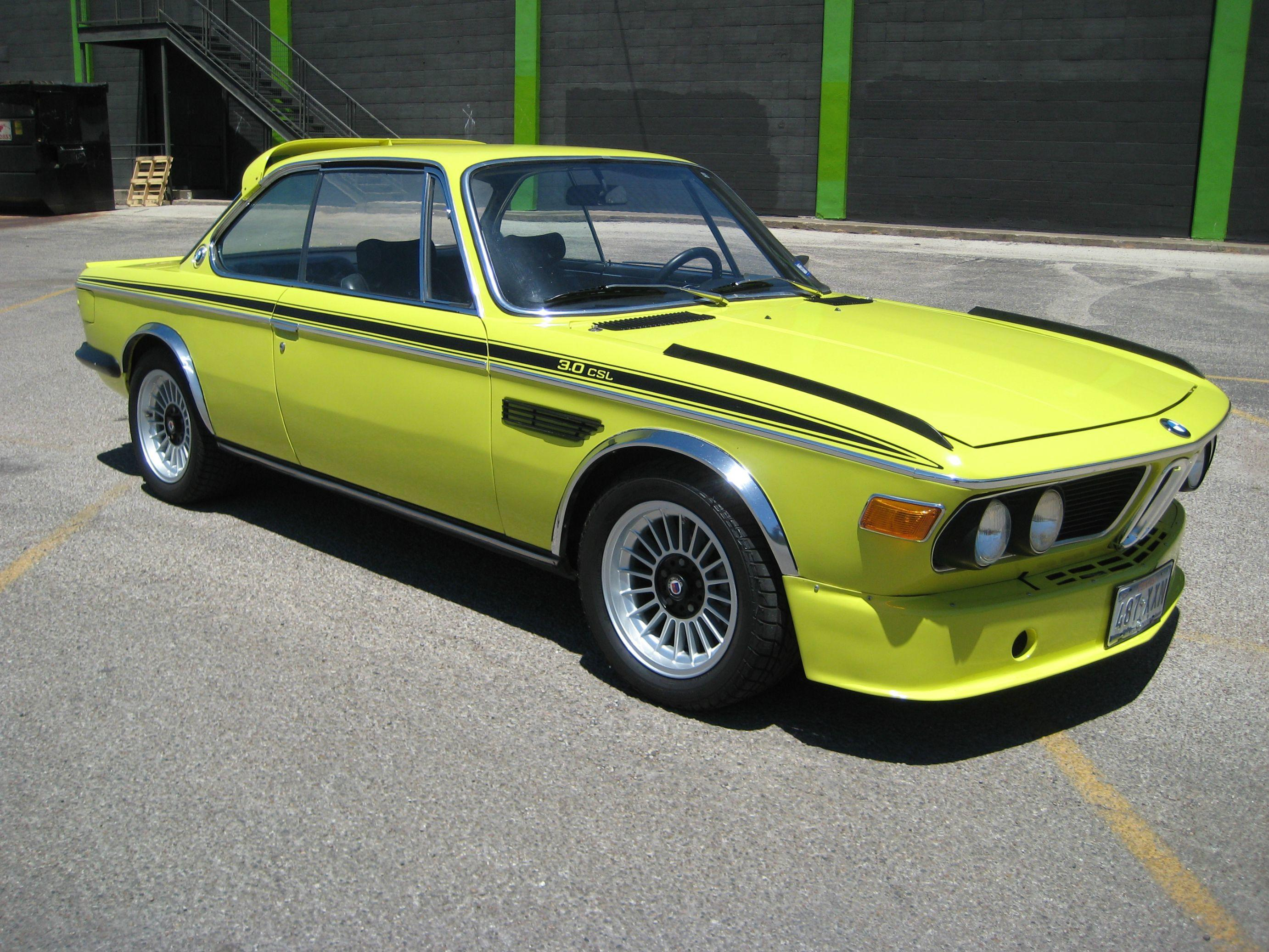 A Classic 1972 BMW 3.0CSL dressed in a lime yellow color