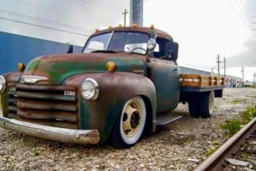 This lowered Chevy 1 ton flatbed looks amazing. Does anyone have any information about it? I'd love to see a build thread